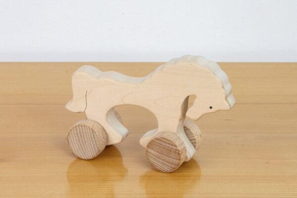 Koń - drewniana figurka na kołach